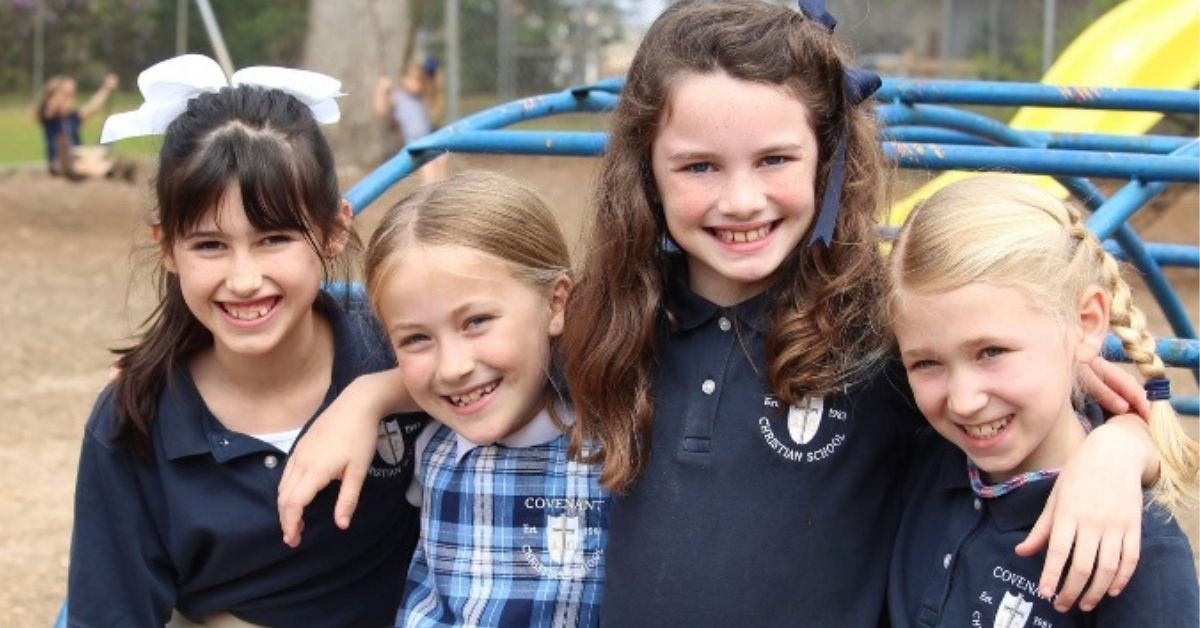 Four girls on playground at private Christian school