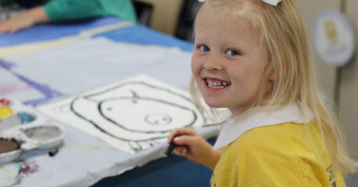 Kindergartener painting in art class for Christian academics