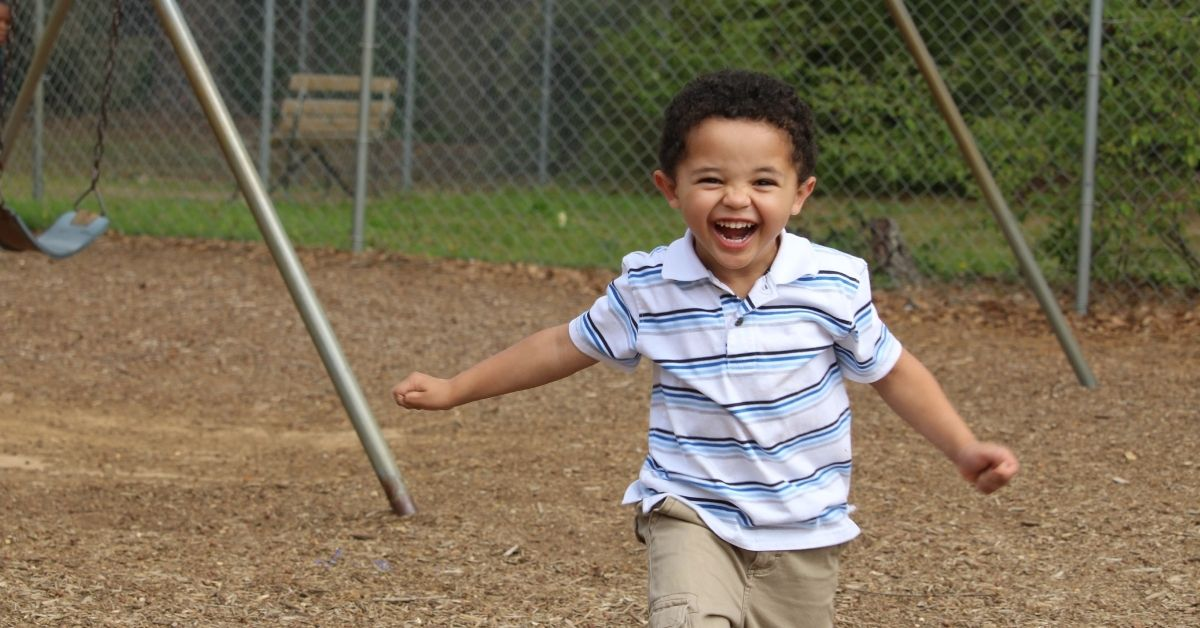 Boy running on playground at CCS Troy